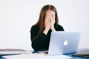 girl stressed whilst working